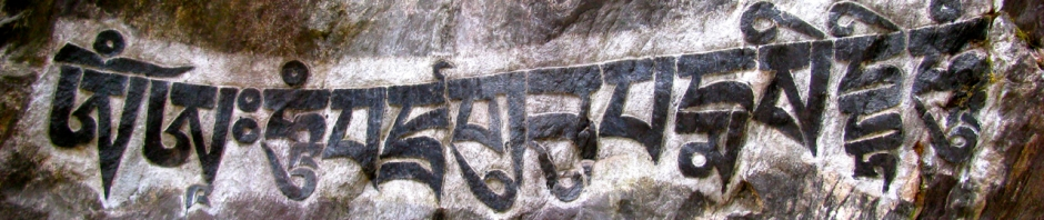 "A Mani Stone in Nepal on which is carved ""Om Mani Padme Om."""