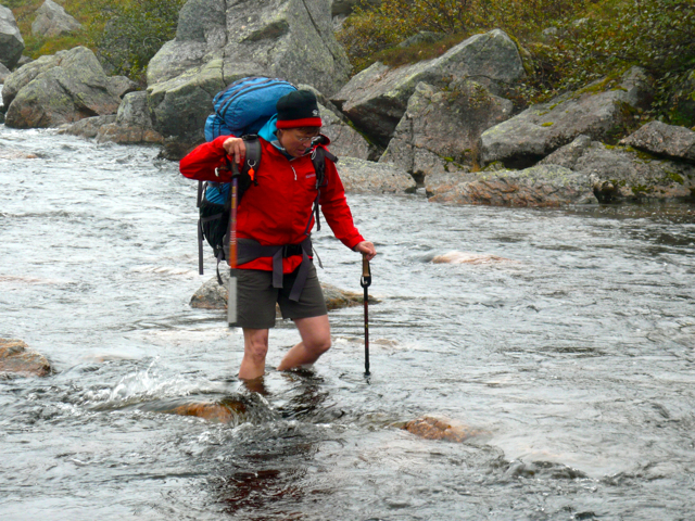 Marian crossing the river in Gros Morne National Park on the Long Range Traverse