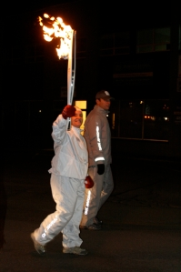 TA carrying the Olympic Torch in the 2010 Torch Relay