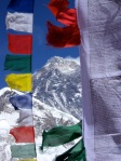 A view of Everest's summit through prayer flags