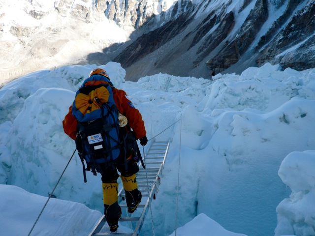 TA crossing a ladder in the Khumbu Icefall