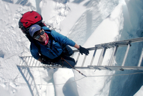 TA on ladder in Khumbu Icefall