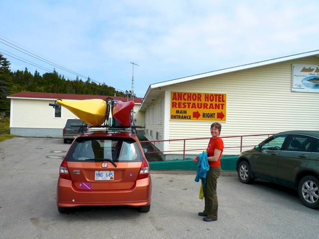Sea kayaks on the car in front of hotel