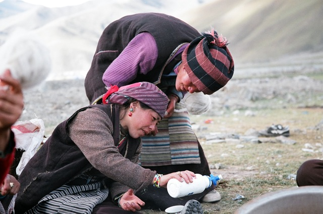 Tibetan women checking out what's in my water bottle