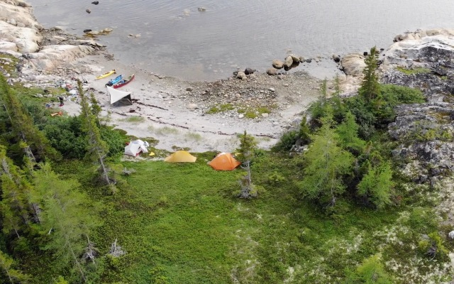 An overhead shot of tents and boats