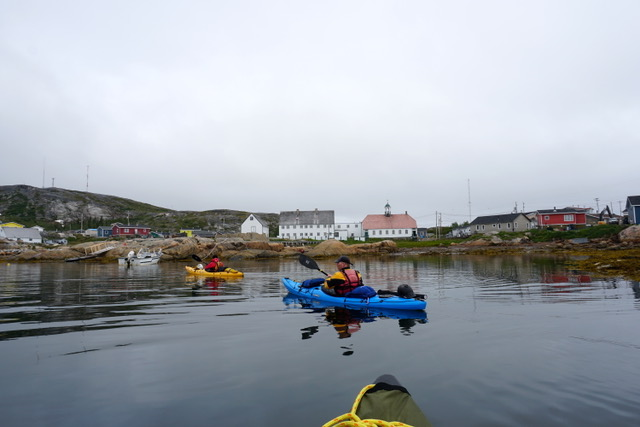 Paddlers entering Hopedale with historic mission in the background