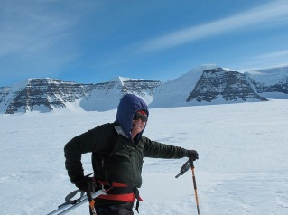 TA in front of mountains in Greenland.