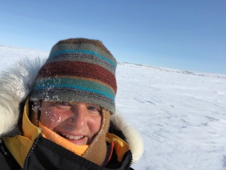TA, with frost on her face, out on the Arctic tundra.